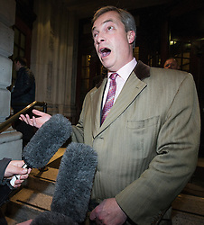 © Licensed to London News Pictures . 26/03/2014 . London , UK . NIGEL FARAGE speaks to media as he leaves the venue after the debate . Liberal Democrat leader and Deputy Prime Minister , Nick Clegg and UKIP leader Nigel Farage , hold the first of two head to head debates on Britain's future in Europe , hosted by LBC Radio , at 8 Northumberland Avenue in London . Photo credit : Joel Goodman/LNP