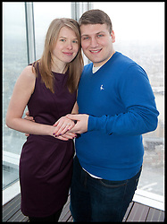James Episcopate 22 proposes to  Laura Taylor 22 both from Essex,  after being together for 5 years as the  London Mayor Boris Johnson officially opens the Shard building to the General public, central London, Friday February 1, 2013. Photo By Andrew Parsons / i-Images