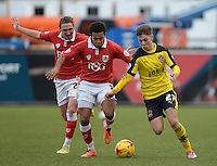 Fleetwood Town's Nick Haughton vies for possession with Bristol City's Korey Smith<br /> <br /> Photographer Ashley Crowden/CameraSport<br /> <br /> Football - The Football League Sky Bet League One - Bristol City v Fleetwood Town - Sunday 1st February 2015 - Ashton Gate - Bristol<br /> <br /> © CameraSport - 43 Linden Ave. Countesthorpe. Leicester. England. LE8 5PG - Tel: +44 (0) 116 277 4147 - admin@camerasport.com - www.camerasport.com