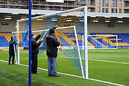 Ground staff preparing pitch for the game during the EFL Sky Bet League 1 match between AFC Wimbledon and Sunderland at Plough Lane, London, United Kingdom on 16 January 2021.