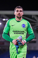 Following his 100th appearance for Brighton & Hove Albion FC Mathew Ryan (GK) (Brighton) returns to the pitch to give his gloves and football boots to some of the children who remained back after the Premier League match between Brighton and Hove Albion and Watford at the American Express Community Stadium, Brighton and Hove, England on 8 February 2020.
