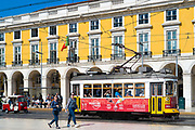 Tram carrying tourists and local people in Praca do Comercio -Terreiro do Paço, in the City of Lisbon, Portugal