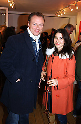 GARY KEMP and his wife LAUREN at a private view of artist Natasha Law's work entitled 'Hold' held at Eleven, 11 Eccleston Street, London SW1 on 12th January 2006.<br />