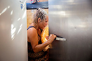 Teri Rubiolo squeezes through fridge doors to store food ingredients in her trailer along Cirby Creek on Wednesday, Oct. 23, 2019, in Magnolia, Calif. Rubiolo has been cooking for Camp Fire victims from her trailer.