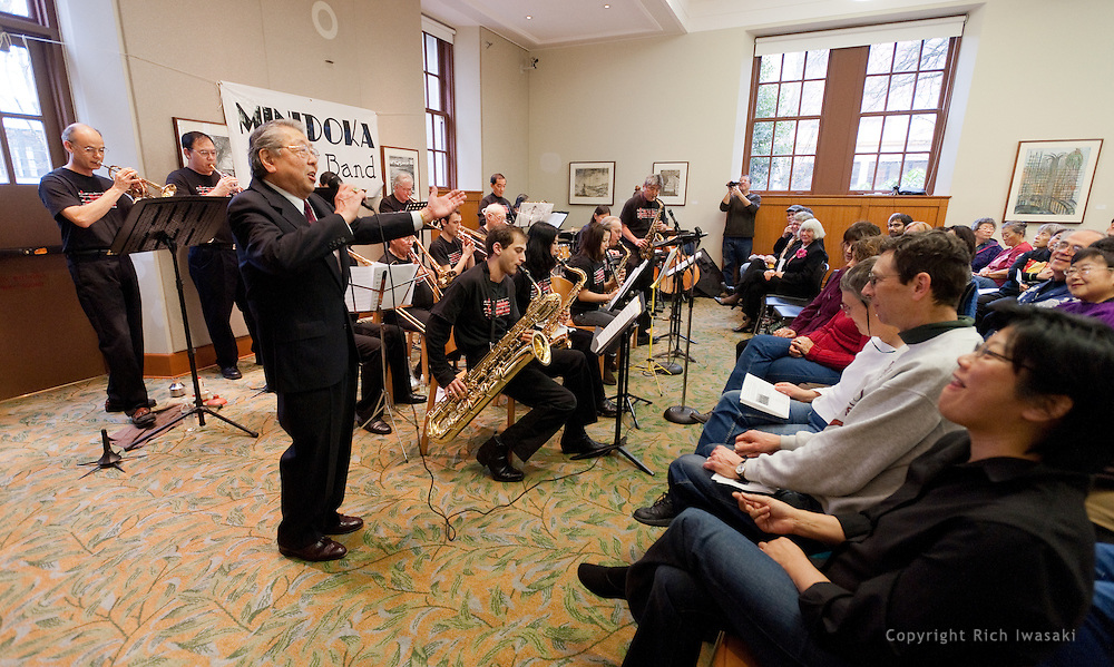 """Vocalist Henry """"Shig"""" Sakamoto performs with the Minidoka Swing Band in the US Bank Room of Multnomah County Library - Central branch, Portland, Oregon. The performance was in conjunction with Portland Center Stage's production of Snow Falling on Cedars, by David Guterson."""
