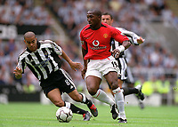 Eric Djemba-Djemba (Manchester United) Kieron Dyer (Newcastle) Newcastle United v Manchester United, FA Premiership, 23/08/2003. Credit: Colorsport / Matthew Impey