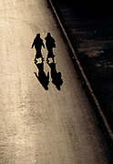 Two Nuns walking across the road in silhouette
