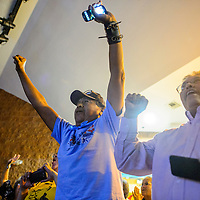 072115       Cable Hoover<br /> <br /> Allen Tsinigine, left, and Paul begay cheer the result of the Navajo language referendum vote as they are posted Tuesday at the Navajo Nation Museum in Window Rock.