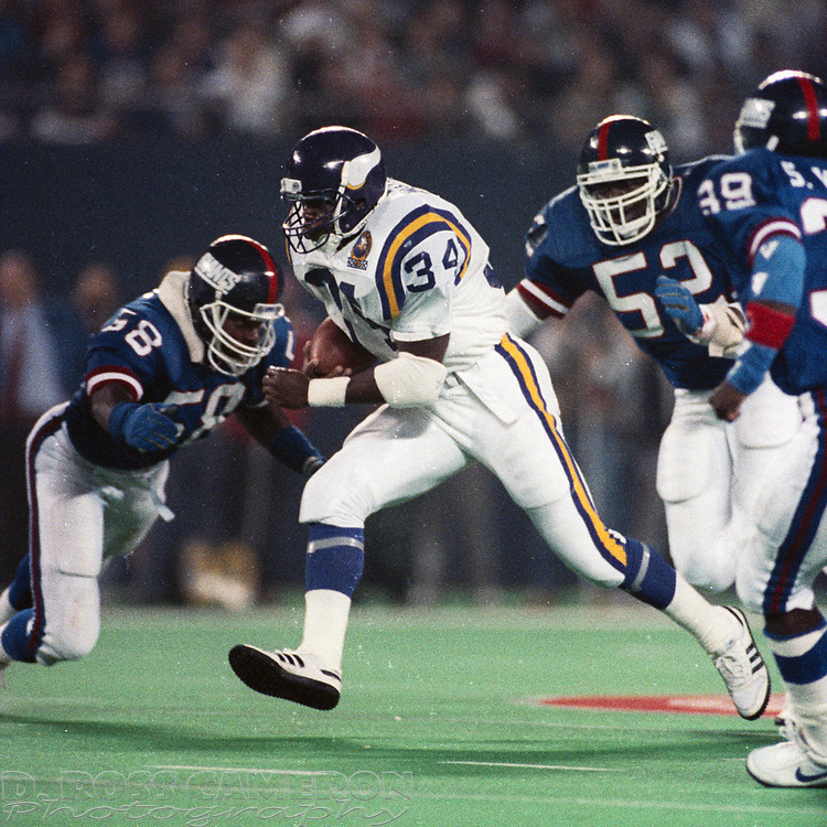Minnesota Vikings running back Herschel Walker (34) breaks free for a 17-yard gain against the New York Giants during an NFL football game, Monday, Oct. 30, 1989 at Giants Stadium in East Rutherford, N.J. Despite this big gainer, Walker rushed for a mere 68 yards in the game, and the Giants won, 24-14. (D. Ross Cameron/The Express)