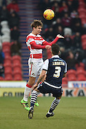 Mitchell Lund of Doncaster Rovers takes ball against Joe Martin of Millwall FC  during the Sky Bet League 1 match between Doncaster Rovers and Millwall at the Keepmoat Stadium, Doncaster, England on 27 February 2016. Photo by Ian Lyall.