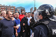 Kosovan police in riot gear fired tear gas and used batons on Thursday to disperse a crowd of some one hundred ethnic Albanians that threw rocks and cans filled with red paint at police in protest over a visit by the Head of Serbia's negotiating team in the Belgrade-Pristina dialogue Borislav Stefanovic, who arrived in Kosovo's capital Pristina in a first official visit since the 1999 Kosovo war on Thursday, May 12. 2011. (Photo/ Vudi Xhymshiti)