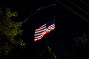 WASHINGTON, USA - August 19: A large American Flag hangs from a crane over the Montgomery County Agricultural Fair in Gaithersburg, Md., USA on August 19, 2017.