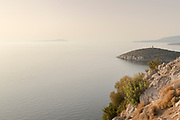 Hill overlooking tranquil Aegean Sea at sunset, Elinda, Chios, Greece