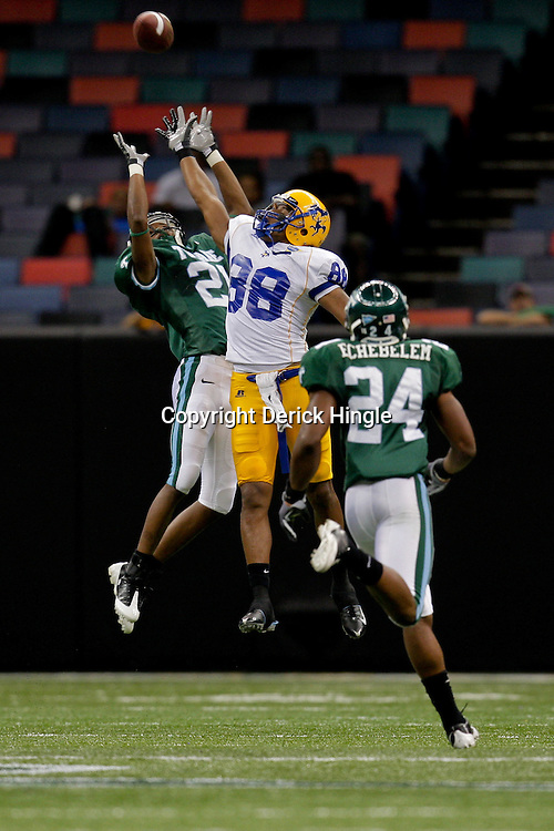 Sep 26, 2009; New Orleans, LA, USA;  Tulane Green Wave cornerback Charles Harris (21) breaks up a pass intended for McNesse State Cowboys wide receiver Immanuel Friddle (88) at the Louisiana Superdome. Tulane defeated McNeese State 42-32. Mandatory Credit: Derick E. Hingle-US PRESSWIRE