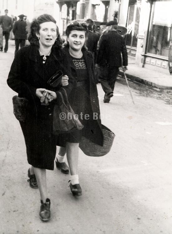 two adult woman walking in the street France ca 1940s