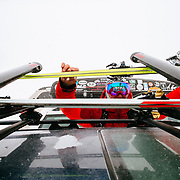 Forrest Jillson puts skis on the car roof rack after a day of skiing in the Teton backcountry.