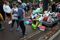 © Licensed to London News Pictures. 03/10/2021. London, UK. A pile of abandoned clothes and bags in Greenwich Park ahead of the start of the London Marathon.This London Marathon will be the first full scale staging of the race in more than two years due to the Coronavirus Pandemic.  Photo credit: George Cracknell Wright/LNP