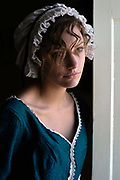"Isabel Snowden, 18, models period costume at the Jane Austen House Museum, Chawton, near Alton, Hampshire, UK<br /> Jane Austen (16 December 1775 – 18 July 1817) was an English novelist whose realism, biting social commentary and masterful use of free indirect speech, burlesque and irony have earned her a place as one of the most widely read and best-loved writers in British literature.<br /> Around early 1809, Austen's brother Edward offered his mother and sisters a more settled life—the use of a large ""cottage"" in Chawton village that was part of Edward's nearby estate, Chawton House. The house is now a museum devoted to Austen and her work"