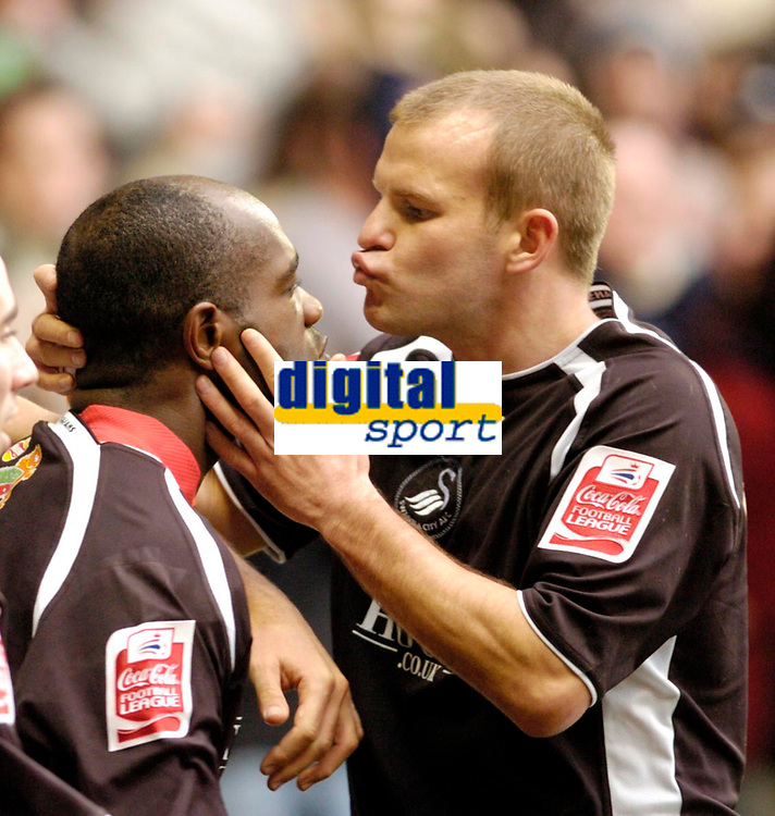 Photo: Leigh Quinnell.<br /> Nottingham Forest v Swansea. Coca Cola League 1. 11/02/2006. Swanseas Andy Robinson plants a big kiss on Adrian Forbes(L) after he scored a goal.