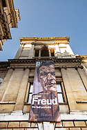 Exhibition poster hanging on the The Royal Academy exterior in London, UK