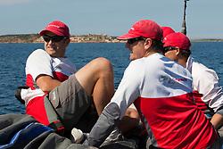 Crew on the bow in between races. Semi-final Artemis (SWE) vs Emirates Team New Zealand (NZL.  La Maddalena, Sardinia, June 4th 2010. Louis Vuitton Trophy  La Maddalena (22 May -6 June 2010) © Sander van der Borch / Artemis