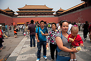 Chinese tourists inside The Forbidden City, a Chinese imperial palace from the Ming Dynasty to the end of the Qing Dynasty. It is located in the middle of Beijing, China, and now houses the Palace Museum. For almost 500 years, it served as the home of emperors and their households, as well as the ceremonial and political center of Chinese government. Built in 1406 to 1420, the complex consists of 980 buildings. The palace complex exemplifies traditional Chinese palatial architecture, and has influenced cultural and architectural developments in East Asia and elsewhere. The Forbidden City was declared a World Heritage Site in 1987, and is listed by UNESCO as the largest collection of preserved ancient wooden structures in the world.