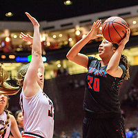 Portales Ram Taylee Rippee (33), left, guards Shiprock Chieftain Aiona Johnson (20) in a District 4A semifinal at The Pit in Albuquerque Thursday.