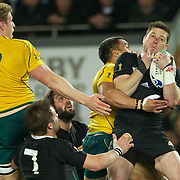 Cory Jane, New Zealand, takes a high kick while challenged by Digby Ioane, Australia, during the New Zealand V Australia Semi Final match at the IRB Rugby World Cup tournament, Eden Park, Auckland, New Zealand, 16th October 2011. Photo Tim Clayton...