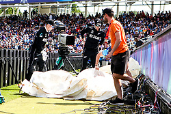 Mitchell Santner of New Zealand and Tom Latham of New Zealand look for the ball which gets lost under the covers by the boundary - Mandatory by-line: Robbie Stephenson/JMP - 03/07/2019 - CRICKET - Emirates Riverside - Chester-le-Street, England - England v New Zealand - ICC Cricket World Cup 2019 - Group Stage