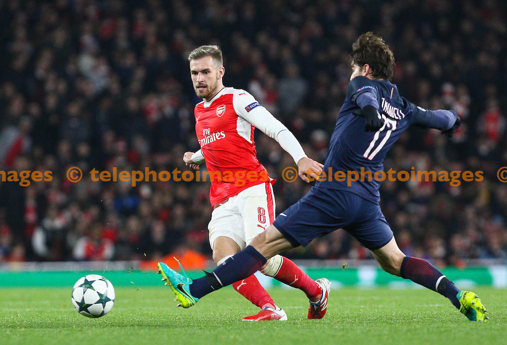 Aaron Ramsey of Arsenal passes the ball during the UEFA Champions League match between Arsenal and Paris Saint-Germain at the Emirates Stadium in London. November 23, 2016.<br /> Arron Gent / Telephoto Images<br /> +44 7967 642437