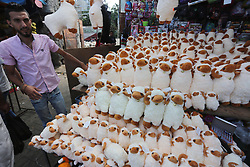 August 31, 2017 - Gaza City, Gaza Strip, Palestinian Territory - Palestinians shop at a market ahead of Eid al-Adha, in Gaza City. Eid al-Adha (the Festival of Sacrifice) is celebrated throughout the Muslim world as a commemoration of Abraham's willingness to sacrifice his son for God, and cows, camels, goats and sheep are traditionally slaughtered on the holiest day.  (Credit Image: © Mohammed Asad/APA Images via ZUMA Wire)