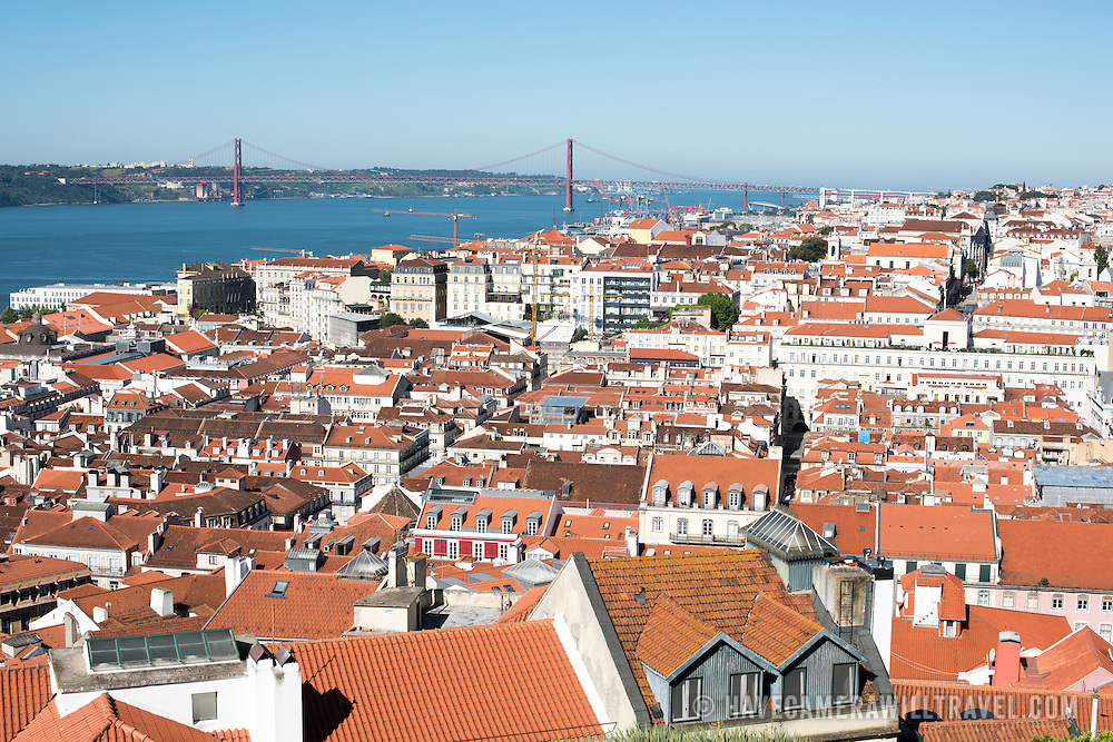 A view of the city of Lisbon and Tagus River, looking west from the walls of the castle. Sitting high on a hill overlooking the center of Lisbon, São Jorge Castle (or Castelo de São Jorge or Saint George Castle) is a Moorish castle. Fortifications have existed on the site for thousands of years, and the current distinctive walls date to the 14th century.