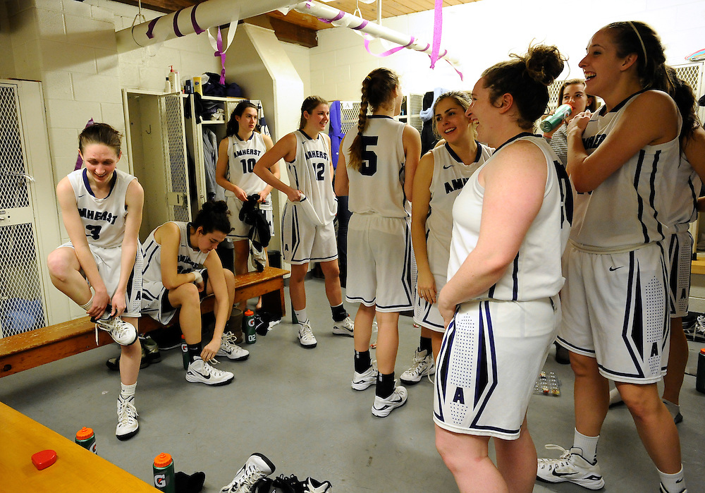 Amherst College plays relax after a game in the locker pom, Friday, Jan. 9, 2015, in Amherst, Mass. Amherst has broken UConn's women's NCAA record with 104 consecutive home victories and is closing in on the Kentucky men's record of 120-plus wins set decades ago. (Jessica Hill for the New York Times)