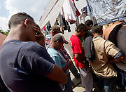 "Migrants pray after having food in the  migrants shelter ""San Juan Diego Cuauhtlatoatzin"" Lechería, Estado de México in this file photo, taken on March 30th, 2012. (Photo: Prometeo Lucero)"