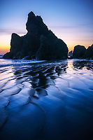 Elegant pattern of beach sand and reflections along Ruby Beach during twilight, Olympic National Park, WA, USA