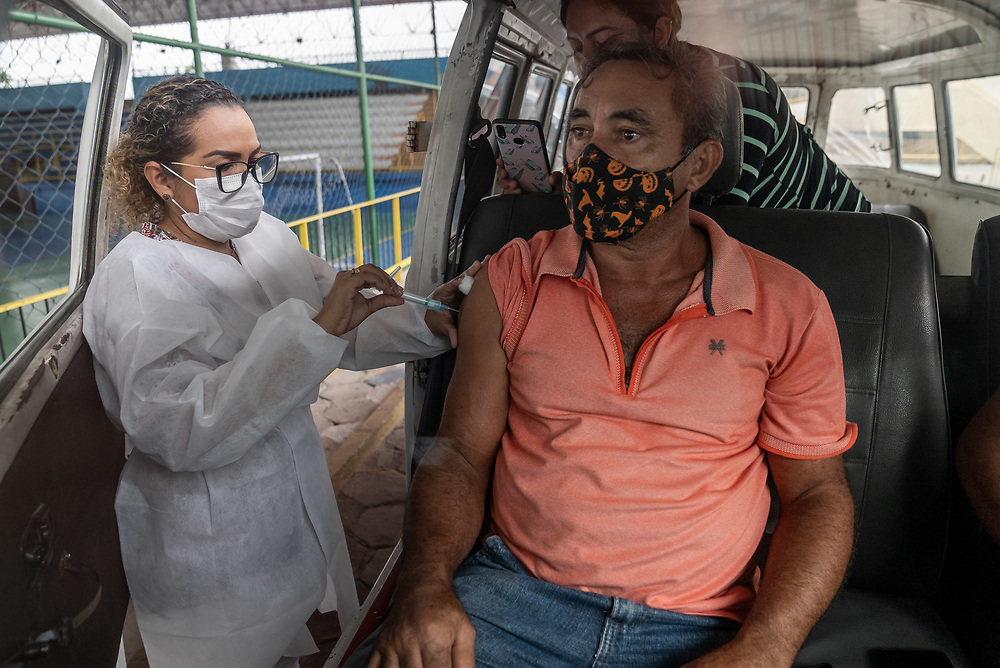 Antonio Edvaldo Pereira Maia, 58, is filmed as he receives the CoronaVac vaccine, also known as the Sinovac COVID-19 vaccine at Club Trabalhador/SESI in Manaus, Brazil March 30, 2021. CoronaVac is an inactivated virus COVID-19 vaccine developed by the Chinese company Sinovac Biotech and has been in Brazil's Phase III clinical trials. Photo Ken Cedeno
