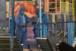 © Licensed to London News Pictures. 14/12/2020. London, UK. Forensic investigators look of over the crime scene on St Anns Road following the fatal stabbing. Police were called at approximately 19:15GMT on Sunday, 13 December to reports of a stabbing in St Anns Road, Harrow. Officers and London Ambulance Service attended. <br /> A man – believed aged in his 20s – was found suffering stab injuries; despite the efforts of the emergency services he was pronounced dead at the scene. Two further males – both believed aged in their late teens – also suffered stab injuries. Photo credit: Peter Manning/LNP