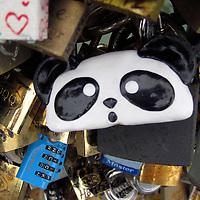 Europe, France, Paris. Panda Love-lock on the Pont de l'Archevêché over the Seine.