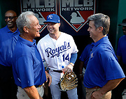Kansas City Royals' outfielder Brett Phillips (14) visits with members of Kansas City's 1985 World Series winning team, including George Brett, left, and Buddy Biancalana, right, with Willie Wilson, back, before a baseball game at Kauffman Stadium in Kansas City, Mo., Saturday, Aug. 11, 2018. The former players took part in a pre-game ceremony, celebrating the Royals' 50th anniversary.  (AP Photo/Colin E. Braley)
