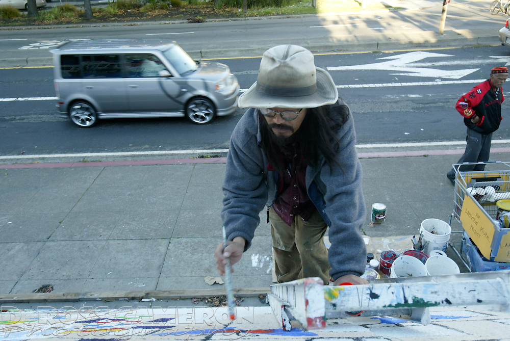 Oakland, Calif. artist Peter Lee works on his portion of the Lakeview mural project near the Grand Lake Theatre, Wednesday, Dec. 27, 2006. (Photo by D. Ross Cameron)