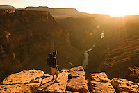 A hiker takes in the view from Toroweap Point in Grand Canyon National Park, Arizona.