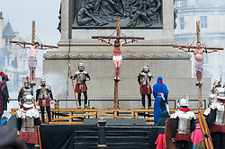 "© Licensed to London News Pictures. 30/03/2018. LONDON, UK. (C) Jesus, played by James Burke-Dunsmore, is crucified. The Wintershall Players present their traditional ""The Passion of Jesus"" play in Trafalgar Square on Good Friday in front of large crowds despite the heavy rain.  The play brings to life the events leading to the crucifixion of Jesus Christ, played by James Burke-Dunsmore, and his subsequent resurrection.  Photo credit: Stephen Chung/LNP"