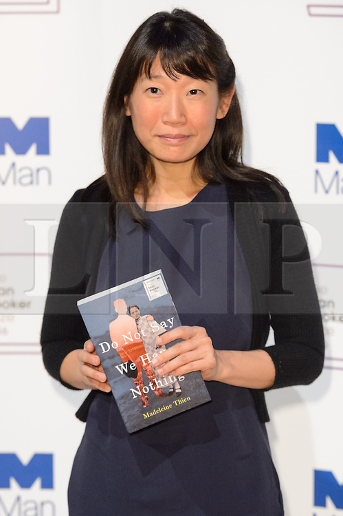 © Licensed to London News Pictures. 24/10/2016. Author MADELEINE THEIN with her book titled Do Not Say We Have Nothing attends the Man Booker Prize for Fiction photocall. London, UK. Photo credit: Ray Tang/LNP