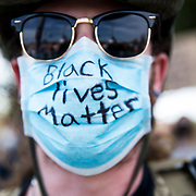 Protesters at a Black Lives Matter demonstration in Simi Valley, a conservative, predominantly white suburb of Los Angeles, in Juneteenth.