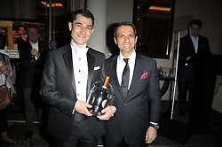 Left to right, STEPHEN MACINTOSH and PAULO DE TURSA front of house at Bar Boulud at the Tatler Restaurant Awards 2011 held at the Langham Hotel, Portland Place, London on 9th May 2011.