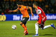 Barnet forward Shaquile Coulthirst (10)  goes past Brentford defender Ezri Konsa (26) during the The FA Cup fourth round match between Barnet and Brentford at The Hive Stadium, London, England on 28 January 2019.