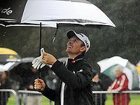 Golf - 2018 Sky Sports British Masters - Sunday, Fourth Round<br /> <br /> Justin Rose of England shelters under an Umbrella from the pouring rain, at Walton Heath Golf Club.<br /> <br /> COLORSPORT/ANDREW COWIE