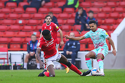 Sammy Ameobi of Nottingham Forest tackles Korey Smith of Swansea City  - Mandatory by-line: Nick Browning/JMP - 29/11/2020 - FOOTBALL - The City Ground - Nottingham, England - Nottingham Forest v Swansea City - Sky Bet Championship