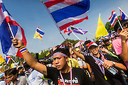 """09 DECEMBER 2013 - BANGKOK, THAILAND: Anti-government protestors march to the gates of Government House in Bangkok. Thai Prime Minister Yingluck Shinawatra announced she would dissolve the lower house of the Parliament and call new elections in the face of ongoing anti-government protests in Bangkok. Hundreds of thousands of people flocked to Government House, the office of the Prime Minister, Monday to celebrate the collapse of the government after Yingluck made her announcement. Former Deputy Prime Minister Suthep Thaugsuban, the organizer of the protests, said the protests would continue until the """"Thaksin influence is uprooted from Thailand."""" There were no reports of violence in the protests Monday.      PHOTO BY JACK KURTZ"""