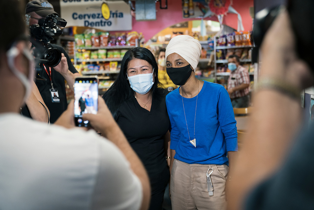 Representative Ilhan Omar, a Democrat from Minnesota, speaks with a voter at Mercado Central in Minneapolis, Minnesota, U.S., on Tuesday, Aug. 11, 2020. Photographer: Ben Brewer/Bloomberg